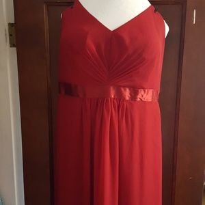 Dark red wedding guest gown with ruffle detail